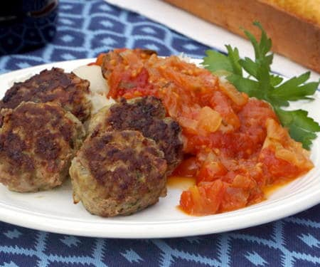 Frikkadel are a lightly spiced South African meatball that are often served with a sweet and herby tomato sauce, making a wonderfully comforting dinner that pairs perfectly with a South African Cabernet Sauvignon. | www.CuriousCuisiniere.com