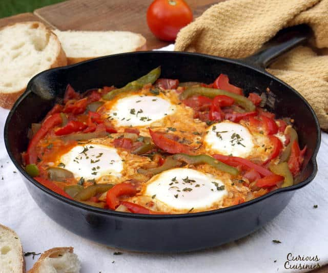 An easy yet hearty African dish of eggs in a fragrant tomato sauce, Chakchouka, also known as Shakshuka, is the perfect, comforting dinner recipe. | www.CuriousCuisiniere.com