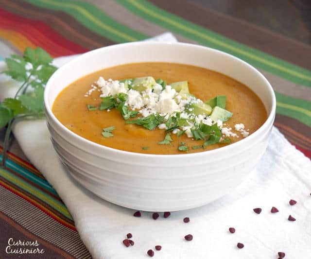 Locro de Papa is a Cheesy Ecuadorian potato soup that is the perfect fall or winter soup for a cool evening. | www.CuriousCuisiniere.com