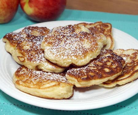 Crispy on the outside, sweet and fluffy on the inside, these Polish apple pancakes are sure to become a fall treat! | www.CuriousCuisiniere.com