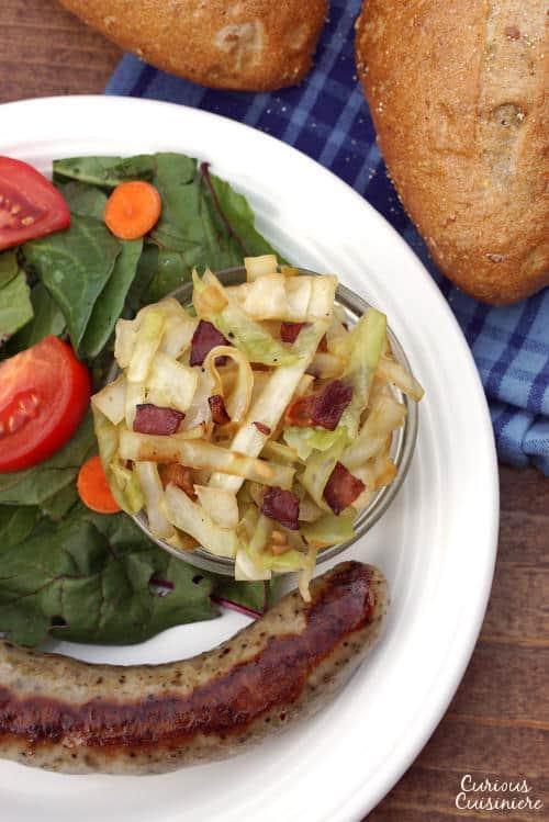Our Kapusta recipe transforms simple cabbage into a flavorful Polish side dish that is studded with bacon! | www.CuriousCuisiniere.com