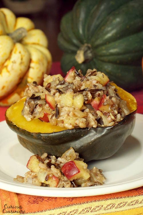 Our Harvest Wild Rice and Apple Stuffed Squash recipe combines sweet apples and crunchy pecans with a hearty wild rice pilaf for a tasty fall dish. | www.CuriousCuisiniere.com
