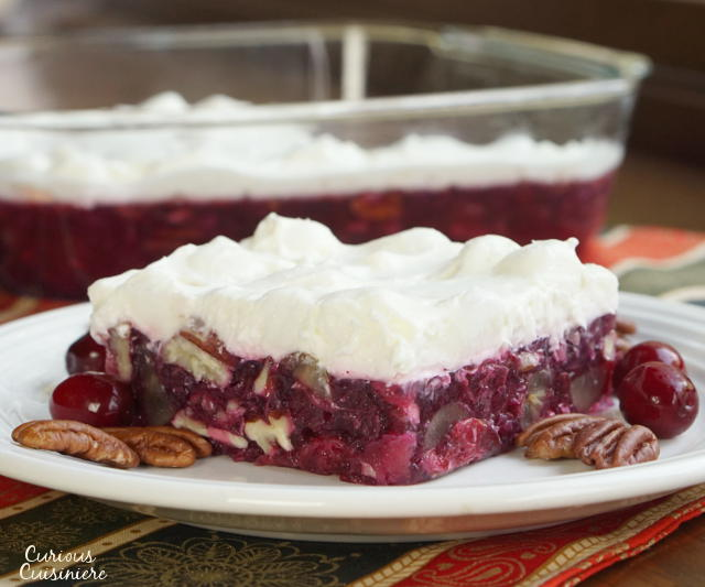 Chock full of crunchy pecans and tart cranberries this Pecan Cranberry Jello Salad proves that your holiday cranberries don't have to be ordinary. | Curious Cuisiniere