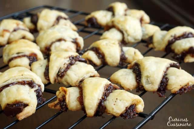 Our Chocolate Raspberry Rugelach and Cinnamon Walnut Rugelach bring a simple pastry dough and crave-worthy fillings together to create irresistible cookies. | www.CuriousCuisiniere.com