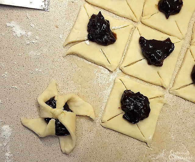 Soft and flaky pasty surrounds a flavorful jam in Joulutorttu, festive Finnish Christmas Star Cookies. | www.CuriousCuisiniere.com