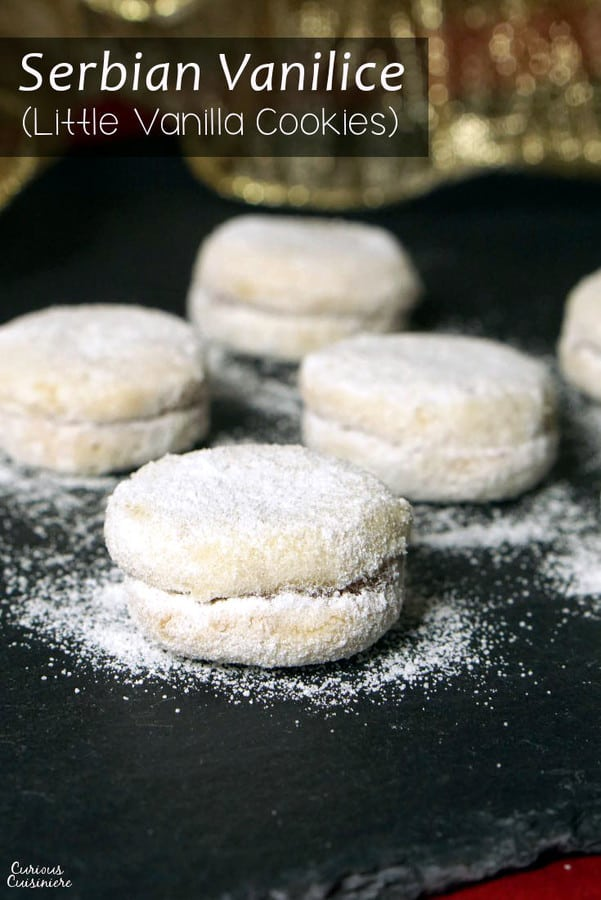 Vanilice are bite-sized Serbian Vanilla Cookies that are seriously addicting. With a nutty sweetness and a soft jam filling, they're the perfect recipe to add to your next cookie platter! | www.CuriousCuisiniere.com