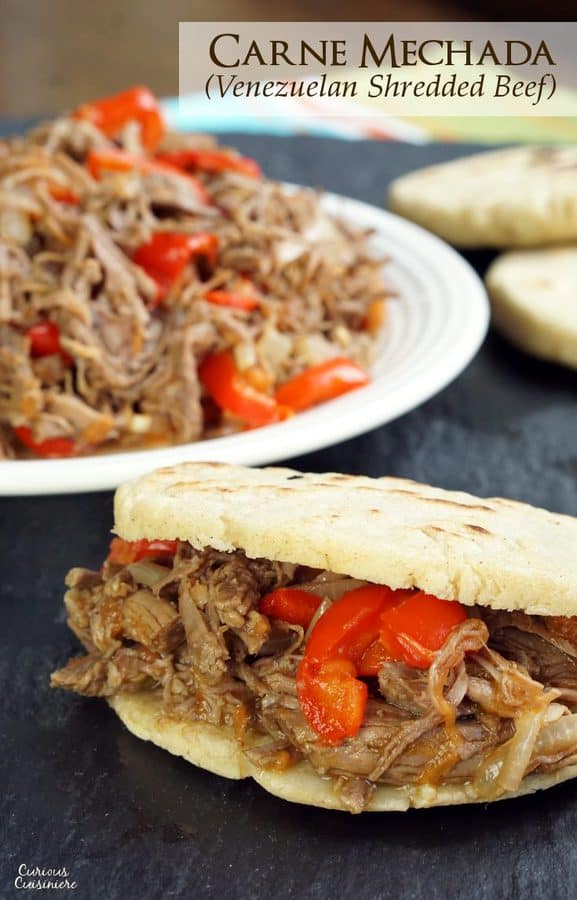 Slow cooked, shredded beef takes on incredible flavor in this Venezuelan Carne Mechada. | www.CuriousCuisiniere.com