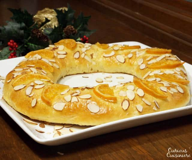 Rosca de Reyes is a soft, lightly sweet, orange scented bread that is traditionally eaten with a cup of hot chocolate on the Feast of the Epiphany. | www.CuriousCuisiniere.com