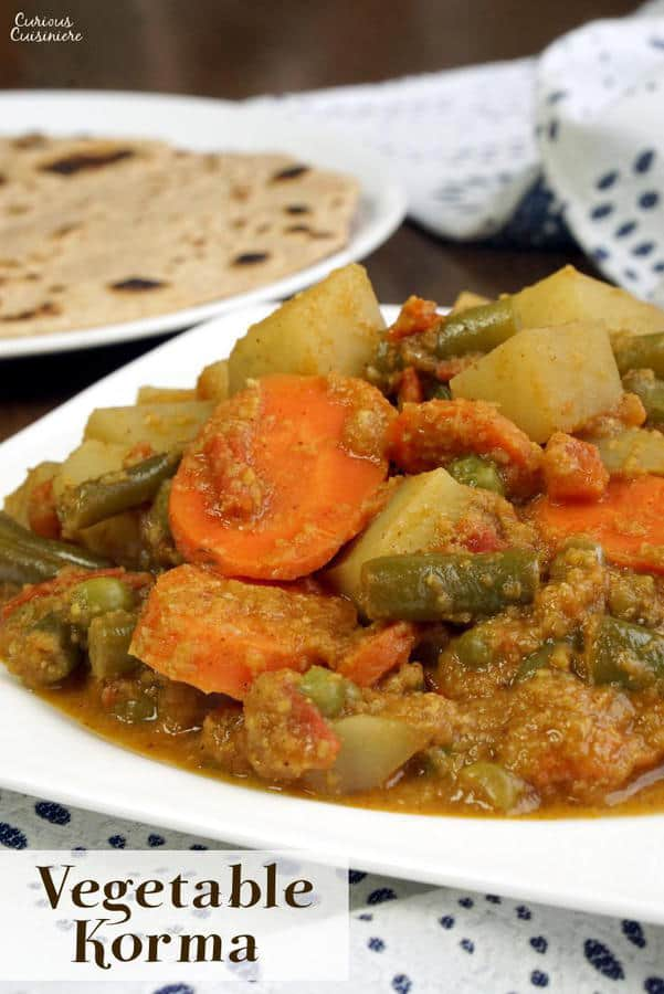 South Indian Vegetable Korma is a creamy coconut curry that is light on spice but big on flavor. This tasty dish is easy enough for a weeknight dinner!   www.CuriousCuisiniere.com