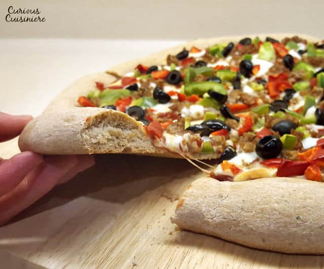 There's no need to wait for pizza night with this quick and easy pizza dough that is ready in less than an hour. | www.CuriousCuisiniere.com