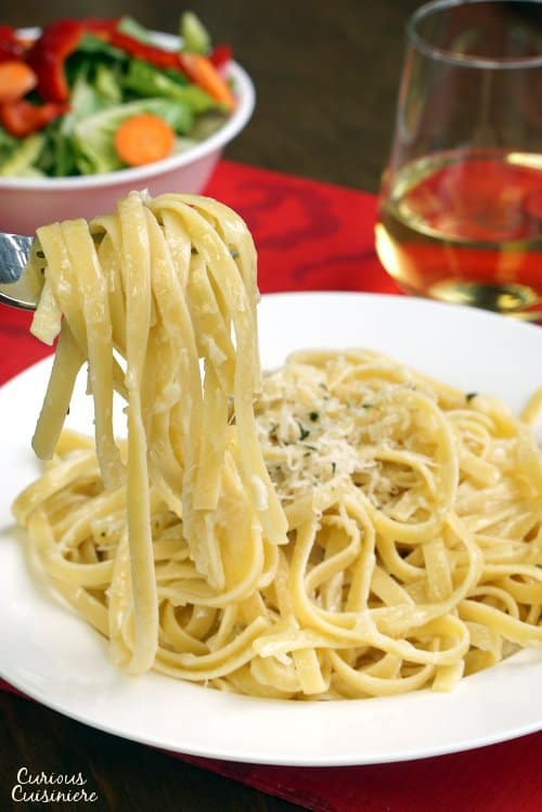 Three ingredients are all you need for authentic Fettuccine Alfredo. It's a dish that just goes to show you can't beat simplicity! | www.CuriousCuisiniere.com