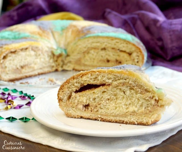 If you've ever wanted to make a Mardi Gras King Cake, this is your year! This traditional Mardi Gras bread is a fun to make treat that everyone will love! | www.CuriousCuisiniere.com