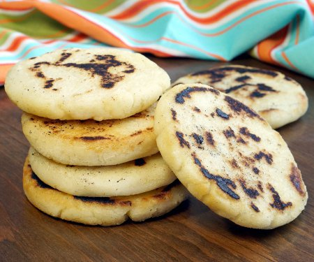 Whether you've wondered how to make arepas or you've never heard of them before, you're sure to fall in love with these easy and versatile South American corn bread rounds! | www.CuriousCuisiniere.com