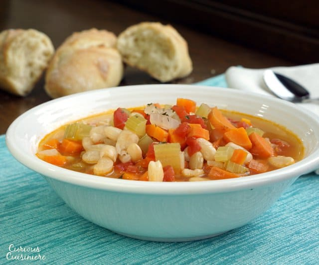 Fasolada is a hearty, healthy, and easy Greek Bean Soup that makes for the perfect vegetarian dinner. | www.CuriousCuisiniere.com