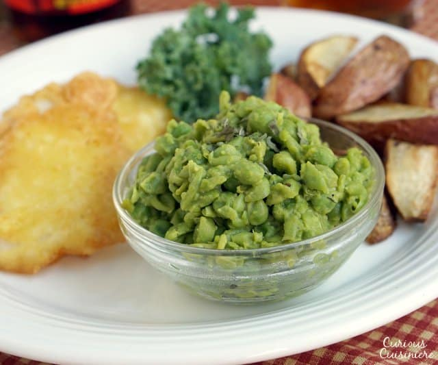 A classic British side dish, Mushy Peas really do bring a whole new dimension to those plain old peas. | www.CuriousCuisiniere.com