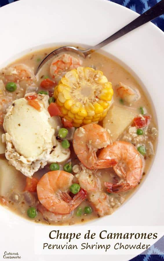 Chupe de Camarones is a unique Shrimp Chowder from Peru that combines a spicy broth with chunky vegetables, poached eggs, and lots of tasty shrimp. This is chowder like you have never seen it before. | www.CuriousCuisiniere.com