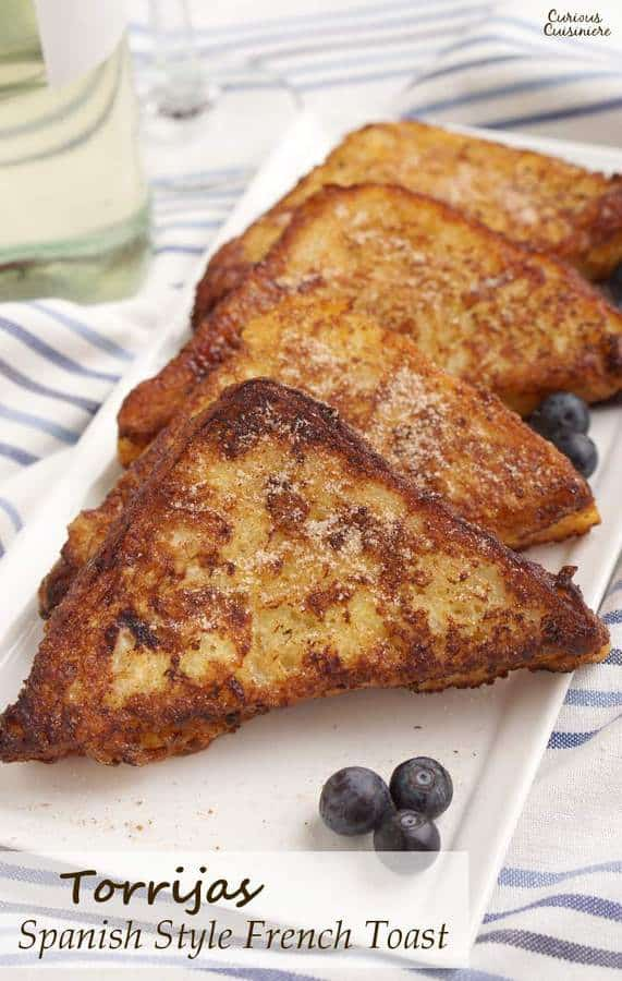 Leave it to the Spanish to think of using wine to soak their French Toast! Torrijas are a traditional Lent and Easter treat made from soaked bread that is deep fried and served with cinnamon sugar or honey. You'll want to give this version of French Toast a try! | www.CuriousCuisiniere.com