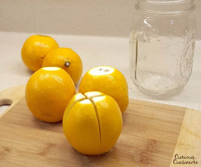 Moroccan Preserved lemons are easy to make and have many uses in traditional African and Middle Eastern cooking as well as unique modern twists. | www.CuriousCuisiniere.com