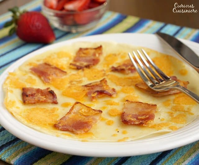 The Dutch pancake, Pannekoek, is a thin pancake that can be served sweet or savory. There are so many ways to enjoy this easy treat for breakfast or a fun snack! | www.CuriousCuisiniere.com