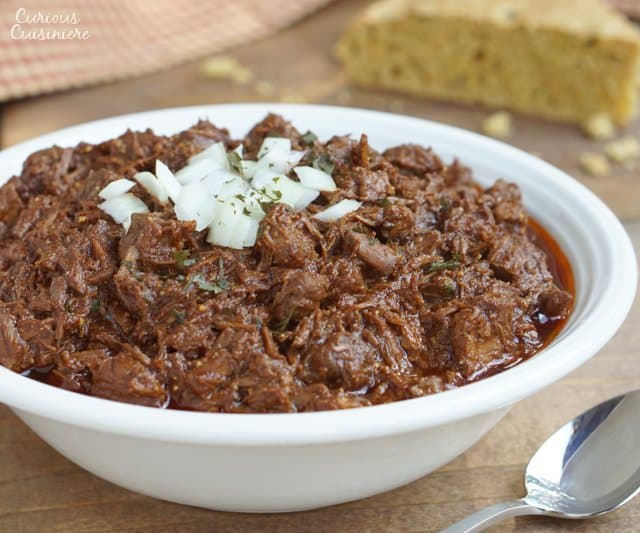 Thick and hearty Cowboy Chili, also known as Texas Red Chili, is sure to stick to your ribs and satisfy any meat lover.  | www.CuriousCuisiniere.com