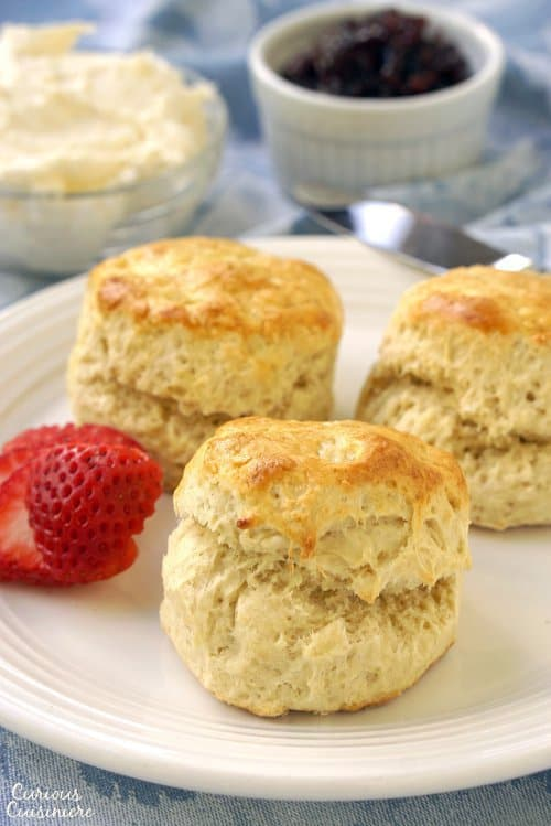 An authentic British Scone is the perfect accompaniment to your warming cup of tea, particularly if you have some clotted cream and jam to serve it with! | www.CuriousCuisiniere.com