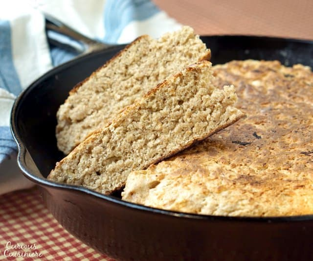 Scottish Bannock bread is cooked in a skillet from a simple dough, making it the perfect recipe for cooking up fresh bread around your summer campfire!   www.CuriousCuisiniere.com