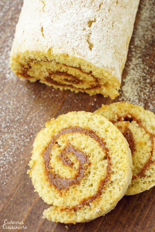 Chilean Brazo de Reina is a simple rolled Dulce de Leche Cake that brings a soft sponge cake together with creamy milk caramel filling for one addicting treat!  | www.CuriousCuisiniere.com