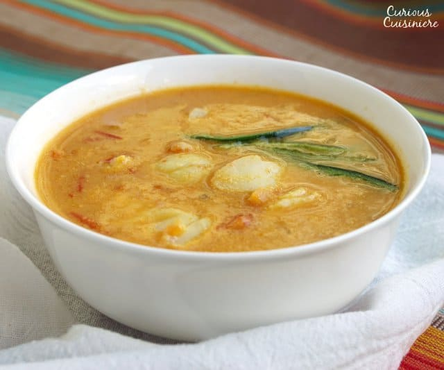 This Goan Fish Curry is a warm and tangy fish curry that is cooled with coconut milk. It's a perfect Indian seafood curry recipe to warm up with! | www.CuriousCuisiniere.com