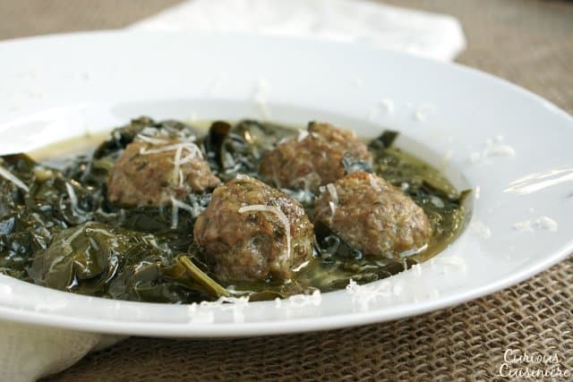 The perfect marriage of hearty meat and healthy greens, our easy Italian wedding soup recipe is quick and tasty, perfect for a chilly day. | www.CuriousCuisiniere.com