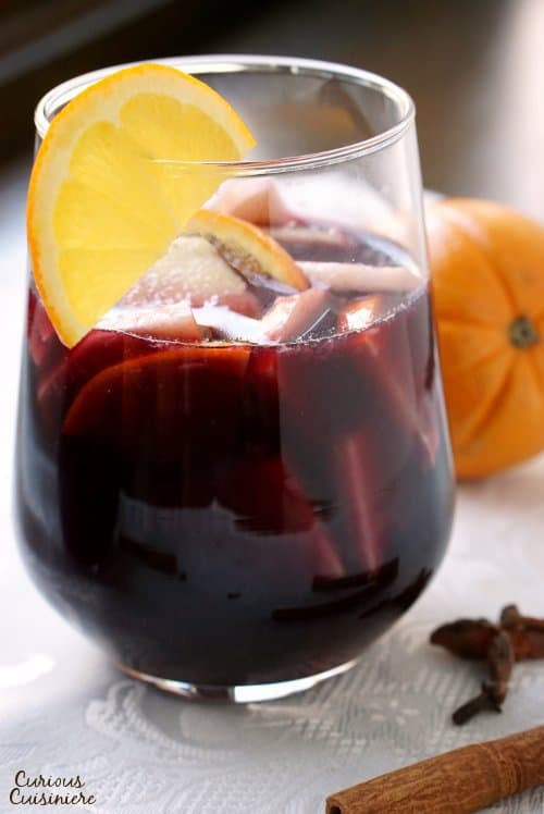 Warm spices and winter fruit make this Spiced Winter Sangria recipe a fun twist on your classic Spanish red sangria. | www.CuriousCuisiniere.com