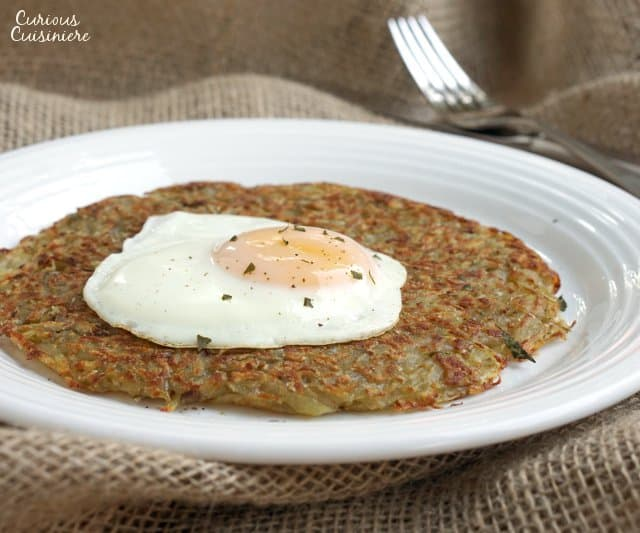 Swiss Potato Rosti is your classic recipe for a satisfying potato pancake. Traditionally eaten for breakfast, we serve our Rosti with eggs. It's the perfect way to start the day! | www.CuriousCuisiniere.com