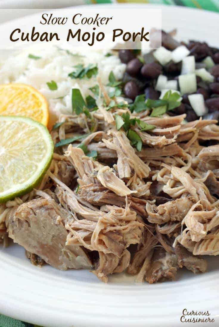 Tender and juicy Cuban Mojo Pork brings robust flavor of garlic and bright citrus notes to this easy, slow cooker recipe. | www.CuriousCuisiniere.com