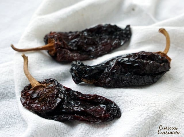 Ancho chilie peppers are low in heat, with a sweet and smoky flavor. | www.CuriousCuisiniere.com