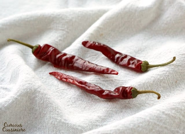 Cayenne chile peppers are bright red and often used dried and powdered.| www.CuriousCuisiniere.com