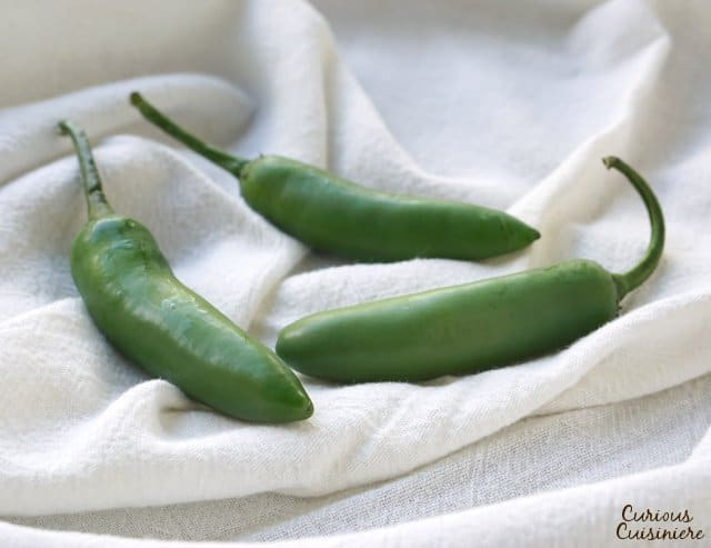 Serrano chilies look like thin jalapenos, but they are hotter, with thick, juicy walls. | www.CuriousCuisiniere.com