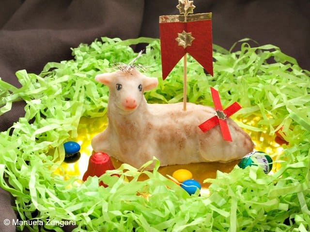 Pecorella-di-Pasqua Marzipan Easter Lamb in a green sreath