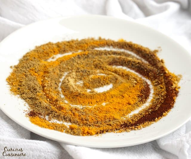 Warm ground spices swirled on a white plate.