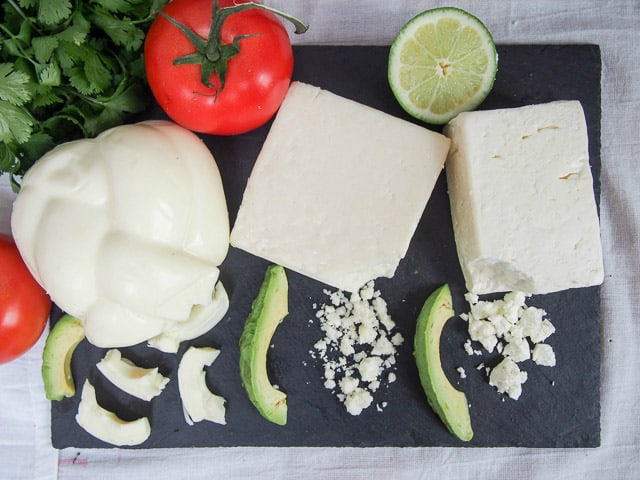 Horizontal spread of Mexican cheese with cotija, queso fresco, and oaxaca.