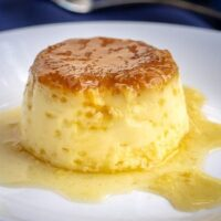 Spanish Flan is an egg custard dessert to make, impressive to serve to guests, and it can be made ahead of time. Spanish egg flan is creamy, caramely, and delicious! | www.CuriousCuisiniere.com