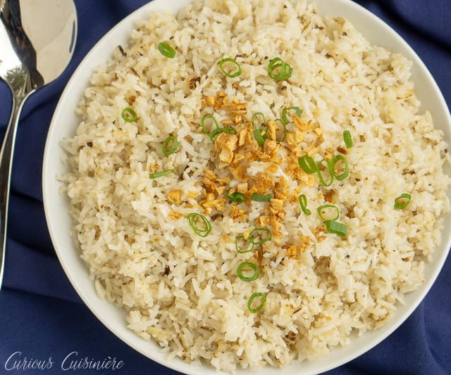 If you've never had Filipino Garlic Fried Rice, then you are missing out. Garlic elevates this simple fried rice recipe, giving it a robust flavor that make it a great side dish, no matter what meal you eat it for! | www.CuriousCuisiniere.com