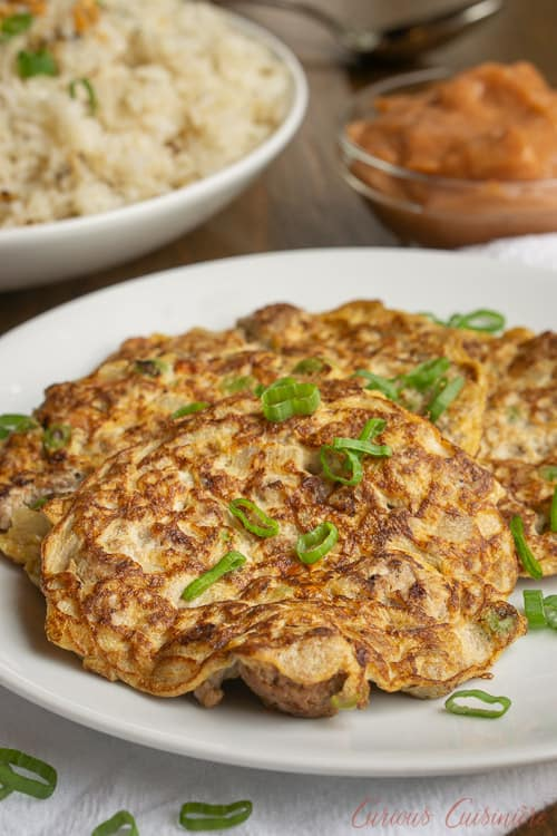 Tortang Giniling is a Filipino ground beef omelette. It is unique in that the omelette is made more like a fritter and is filled with lots of beef and veggies. It is a delicious recipe for breakfast or for a light lunch or snack.  | www.CuriousCuisiniere.com