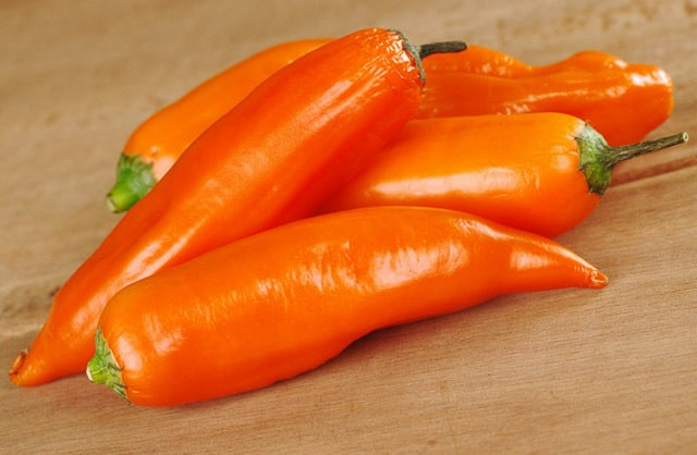 Aji Amarillo - Native to South America, these bright orange chiles have a thick flesh and a hot heat level.