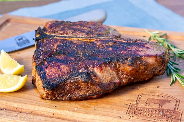 Bistecca alla Fiorentina is an impressive dish of Porterhouse steak done Florentine style. This Florentine steak is a simple recipe, perfect for a summer dinner party. | www.CuriousCuisiniere.com