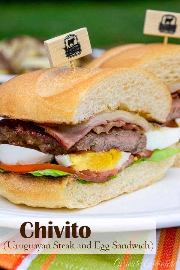 Chivito, the national dish of Uruguay, is a steak and egg sandwich unlike any other. This ultimate steak sandwich is perfect for a summer lunch or dinner! #sandwich #steaksandwich #bestangusbeef #steakandeggs | www.CuriousCuisiniere.com