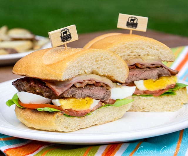 Chivito, the national dish of Uruguay, is a steak and egg sandwich unlike any other. This ultimate steak sandwich is perfect for a summer lunch or dinner! | www.CuriousCuisiniere.com