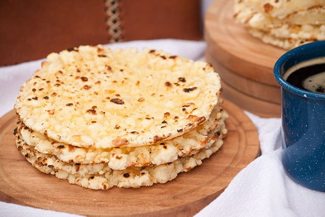 Mbejú is a buttery, gluten-free, cheese flatbread with crispy edges that is made with cassava flour and enjoyed all over Paraguay with a cup of coffee or cocido tea. | www.CuriousCuisiniere.com