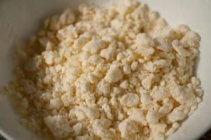 Cassava flour, cheese, butter, and a pinch of salt make up this crumbly mbeju dough mixture. | www.CuriousCuisiniere.com