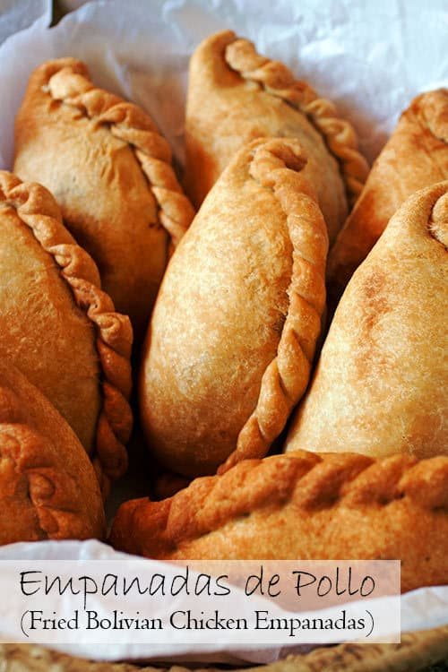 With a crispy-sweet crust and a juicy chicken filling, Empanadas de Pollo, Bolivian chicken empanadas, are a great recipe for your next get together. #empanadas #chickenfilling #bolivian | www.CuriousCuisiniere.com
