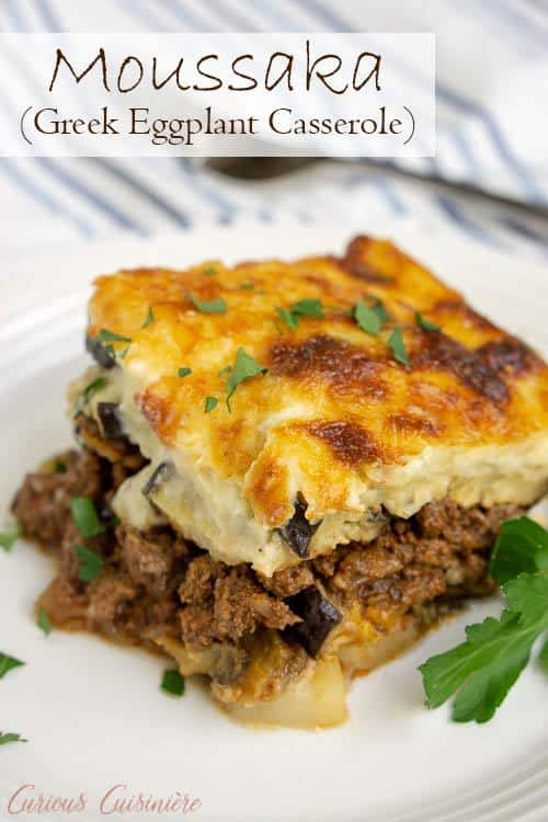 Greek Moussaka is an eggplant casserole filled with layers of eggplant and a warmly spiced meat sauce, all covered in a rich béchamel sauce. This is a recipe for some serious Greek comfort food! #eggplant #casserole #comfortfood | www.CuriousCuisiniere.com