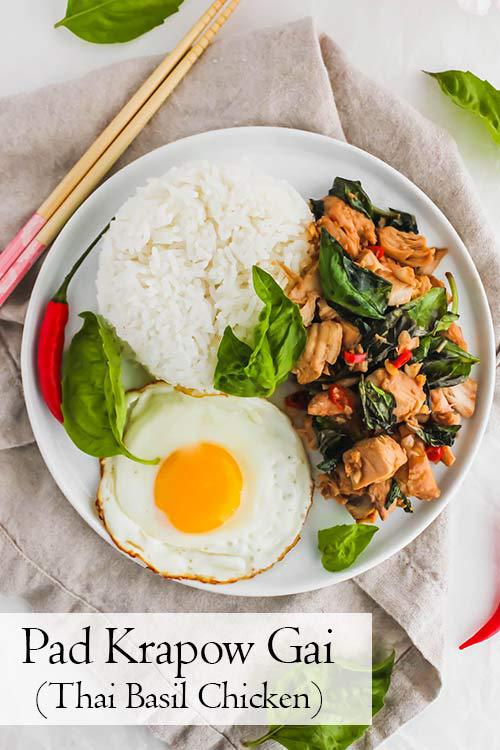 Pad Krapow Gai, Thai Basil Chicken, is savoury, aromatic, and garlicky. This recipe is so comforting and delicious served over rice with a fried egg. #basil #stirfry #thaifood | www.CuriousCuisiniere.com